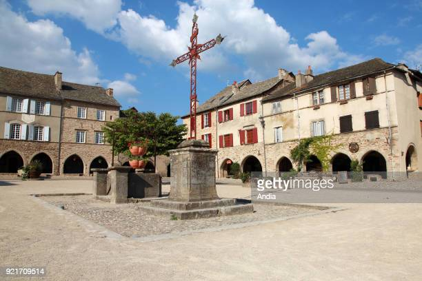 traditional houses in the square 'place de la Bastide' Facades of traditional houses and arches of the former Royal bastide The village is registered...