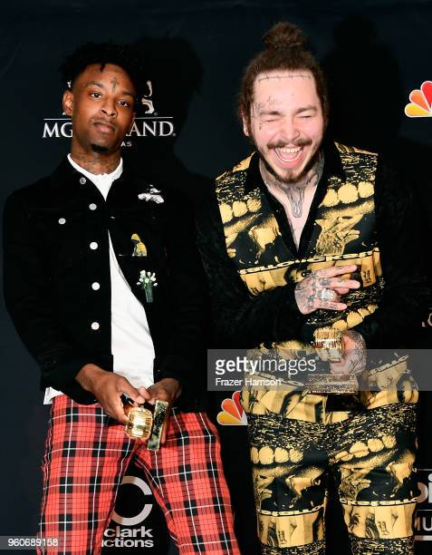 21 Savage and Post Malone poses in the press room during the 2018 Billboard Music Awards at MGM Grand Garden Arena on May 20 2018 in Las Vegas Nevada
