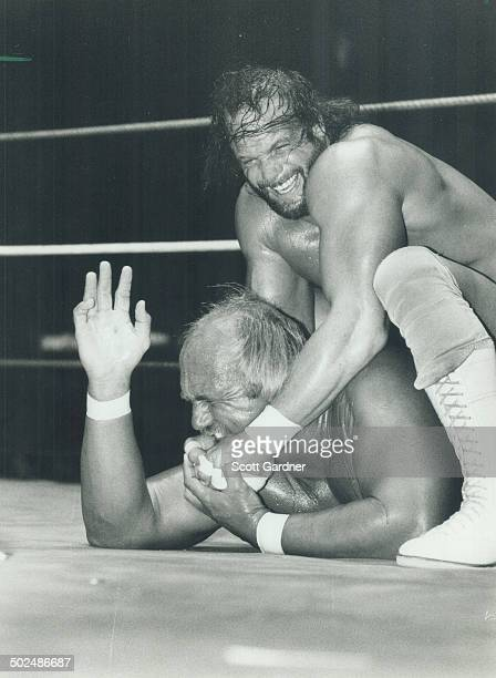 Savage assault Looks like Randy Savage has a firm grip on champion Hulk Hogan and the WWF title doesn't it Nope The Hulk struck back