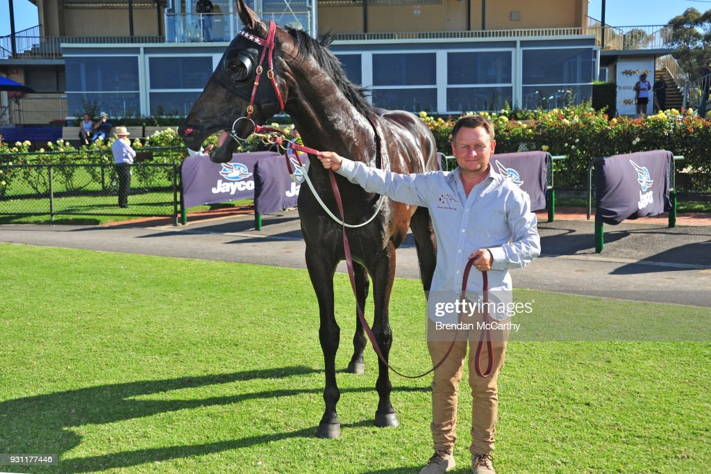 Savaheat (NZ) and strapper Dean Larsson after winning the Hygain BM78 Handicap at Bendigo Racecourse on March 13, 2018 in Bendigo, Australia.