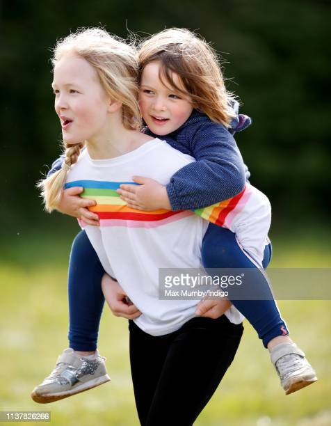 Savanah Phillips gives her cousin Mia Tindall a piggyback as they attend the Gatcombe Horse Trials at Gatcombe Park on March 23 2019 in Stroud England