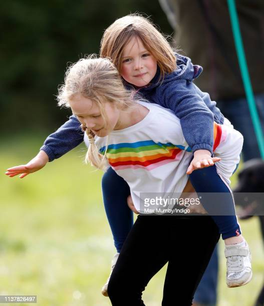 Savanah Phillips gives her cousin Mia Tindall a piggyback as they attend the Gatcombe Horse Trials at Gatcombe Park on March 23, 2019 in Stroud,...