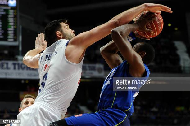 Savane #17 of Movistar Estudiantes and Felipe Reyes #9 forward of Real Madridduring the Liga Endesa game between Real Madrid and Estudiantes at...