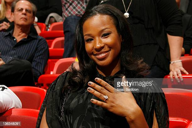 Savannah Brinson fiance of LeBron James of the Miami Heat poses for a picture with her engagement ring during the game against the Atlanta Hawks on...