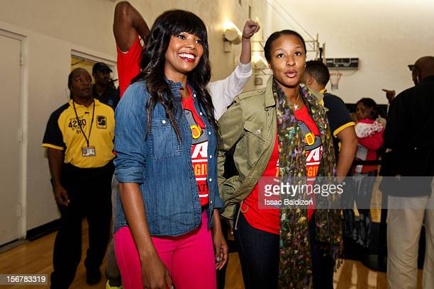 Savannah Brinson right fiancée of LeBron James of the Miami Heat and actress Gabrielle Union girlfriend of Dwyane Wade of the Heat participate in the...