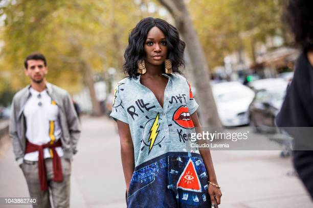 Savannah Britt wearing a printed dress is seen before the Valentino show on September 30 2018 in Paris France