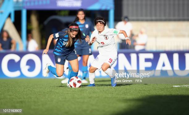 Savannah Demelo of the United States is challenged by Hinata Miyazawa of Japan during the FIFA U-20 Women's World Cup France 2018 group C match...