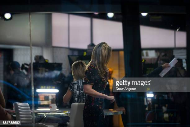 Savannah Guthrie walks on the set of NBC's Today Show November 29 2017 in New York City It was announced on Wednesday morning that long time Today...