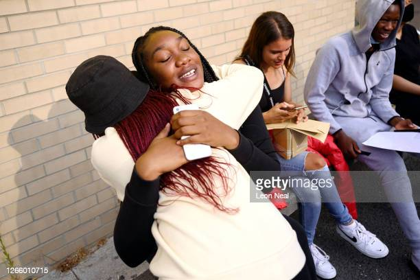 Savannah Kanu is hugged by a friend after successfully gaining entry to her university of choice after receiving their A level results at City...