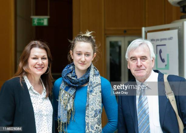 Savannah Lovelock from Extinction Rebellion poses with Shadow Chancellor John McDonnell and Shadow Environment Secretary Sue Haymanat after a meeting...