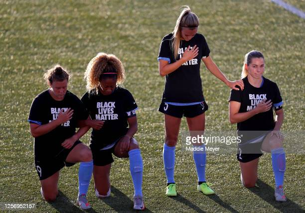 Savannah McCaskill, Casey Short, Rachel Hill of Kealia Watt of Chicago Red Stars kneel and stand in Black Lives Matter T-shirts during the national...
