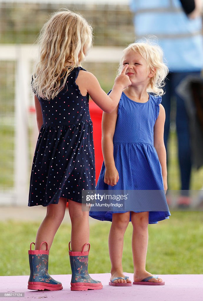 Savannah Phillips and Isla Phillips lark around as they attend day 1 of the Festival of British Eventing at Gatcombe Park on August 5, 2016 in Stroud, England.