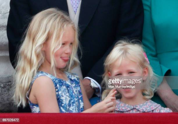 Savannah Phillips and Isla Phillips watch the flypast from the balcony of Buckingham Palace during the annual Trooping the Colour Parade on June 17...