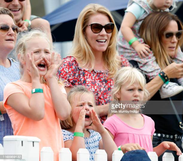 Savannah Phillips, Autumn Phillips, Mia Tindall and Isla Phillips cheer as they watch the Shetland Pony Grand National on day 2 of the 2019 Festival...