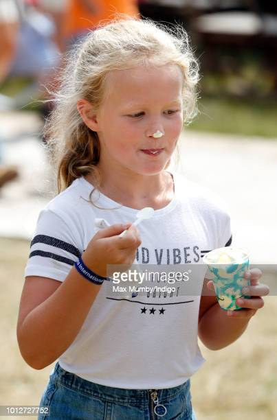 Savannah Phillips eats an ice cream as she attends day 1 of The Festival of British Eventing at Gatcombe Park on August 3 2018 in Stroud England