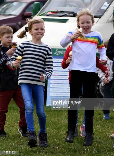 Savannah Phillips enjoys an ice cream at the Land Rover Novice & Intermediate Horse Trials at Gatcombe Park on March 23, 2019 in Stroud, England.