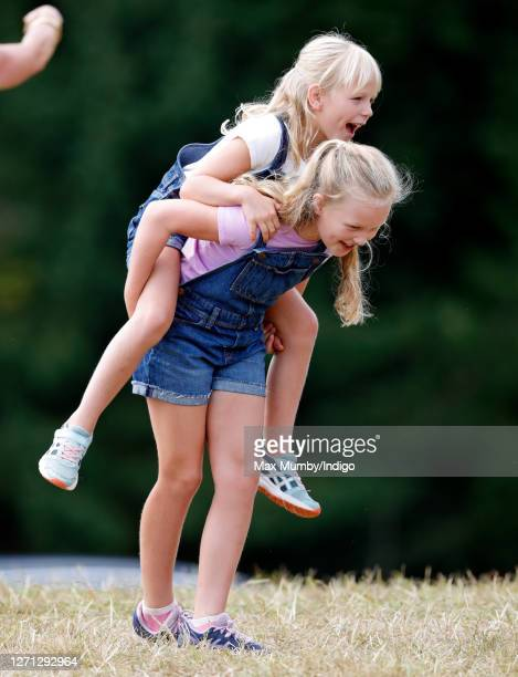 Savannah Phillips gives her sister Isla Phillips a piggyback as they attend day 1 of the 2019 Festival of British Eventing at Gatcombe Park on August...