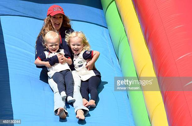Savannah Phillips Isla Phillips and family friend Megan McCarthy play on a bouncy slide during the Festival of British Eventing at Gatcombe Park on...