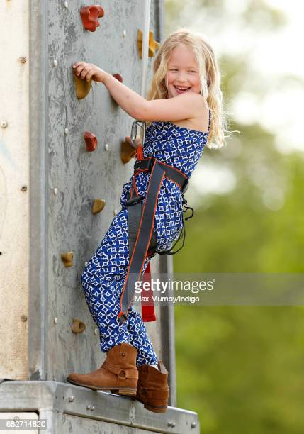 Savannah Phillips plays on a climbing wall as she accompanied by her parents Peter and Autumn Phillips attends day 4 of the Royal Windsor Horse Show...