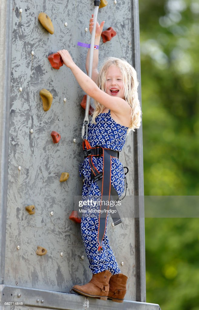 Savannah Phillips plays on a climbing wall as she, accompanied by her parents Peter and Autumn Phillips, attends day 4 of the Royal Windsor Horse Show in Home Park on May 13, 2017 in Windsor, England.