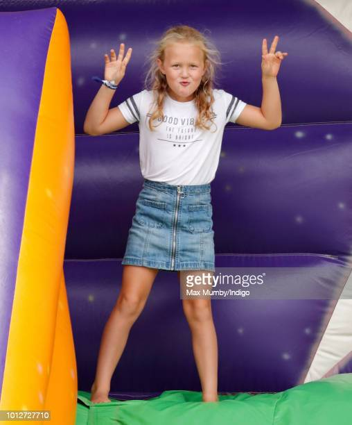 Savannah Phillips plays on an inflatable bouncy slide as she attends day 1 of The Festival of British Eventing at Gatcombe Park on August 3 2018 in...