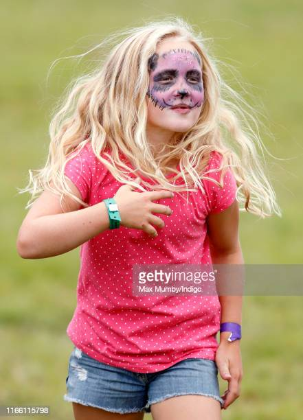 Savannah Phillips, seen wearing animal design face paint, attends day 3 of the 2019 Festival of British Eventing at Gatcombe Park on August 4, 2019...