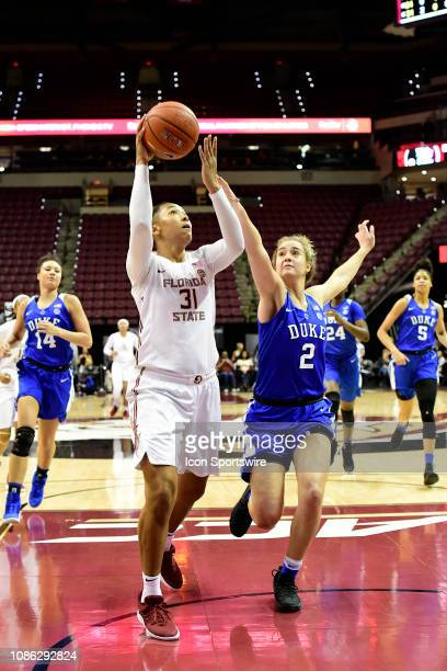 Savannah Wilkinson guard Florida State University Seminoles sets to make two points on the break from the paint against Haley Gorecki guard Duke...