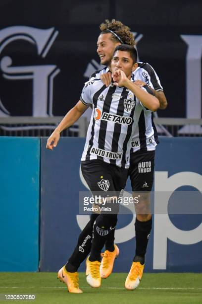 Savarino of Atletico MG celebrates with Guga after scoring a goal during a match between Atletico MG and Santos as part of Brasileirao Series A 2020...