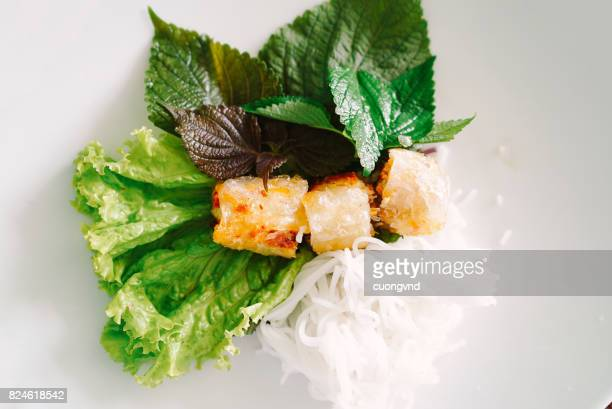 Save Download Preview Vietnamese food spring roll or cha gio a delicious fried food with cylinder shape eat with bun salad and fish sauce this also rich calories cholesterol fatty food popular Vietnam eating
