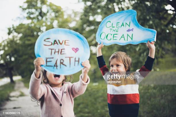 save our childhood by saving the environment! - climate change stock pictures, royalty-free photos & images