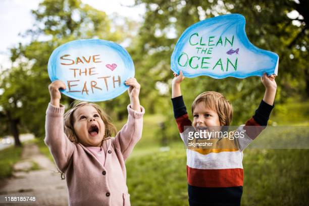 save our childhood by saving the environment! - rescue stock pictures, royalty-free photos & images