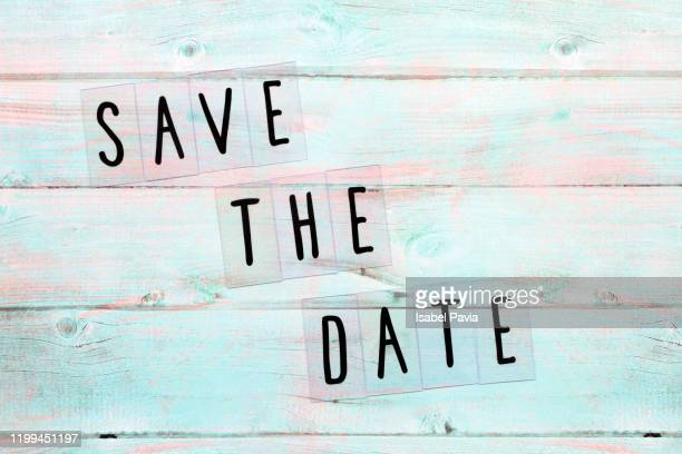 save the date... message on blue background - invitation stock pictures, royalty-free photos & images