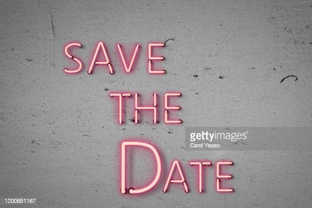 save the date written in neon lights - save the date stock pictures, royalty-free photos & images
