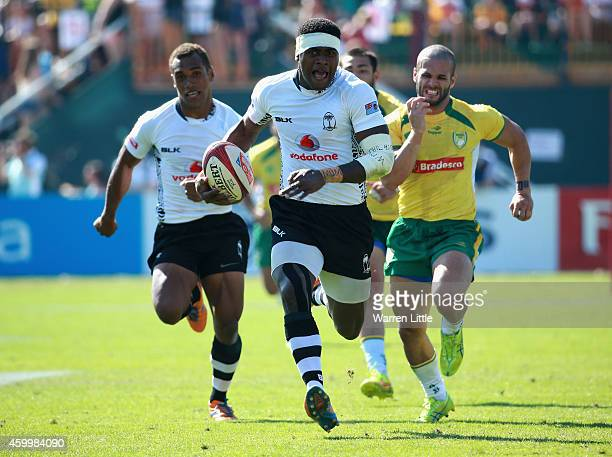 Savenaca Rawaca of Fiji scores a try against Brazil during day one of the Emirates Dubai Sevens HSBC Sevens World Series on December 5 2014 in Dubai...