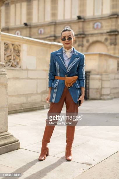 Savina Chai is seen on the street attending THOM BROWNE during Paris Fashion Week AW19 wearing THOM BROWNE on March 03 2019 in Paris France