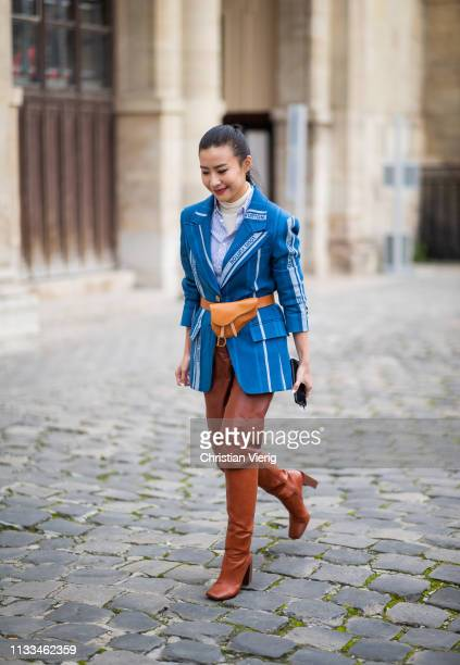 Savina Chai is seen wearing Dior belt bag outside Thom Browne during Paris Fashion Week Womenswear Fall/Winter 2019/2020 on March 03, 2019 in Paris,...