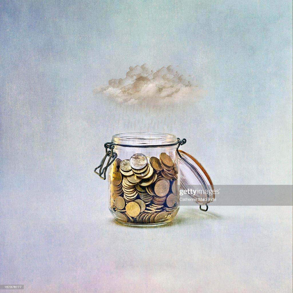 Saving for rainy day : Stock Photo