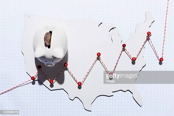 saving growth line graph with piggy bank - push pin stock pictures, royalty-free photos & images