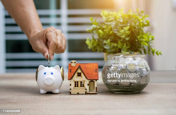saving money for buy home concept - real estate stock pictures, royalty-free photos & images