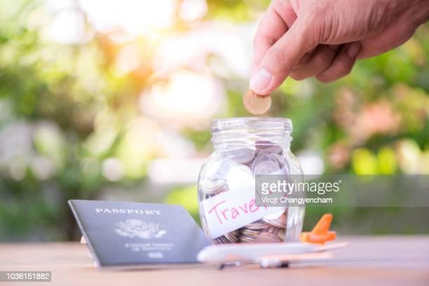 saving money for teavel and vacation - erschwinglich stock-fotos und bilder