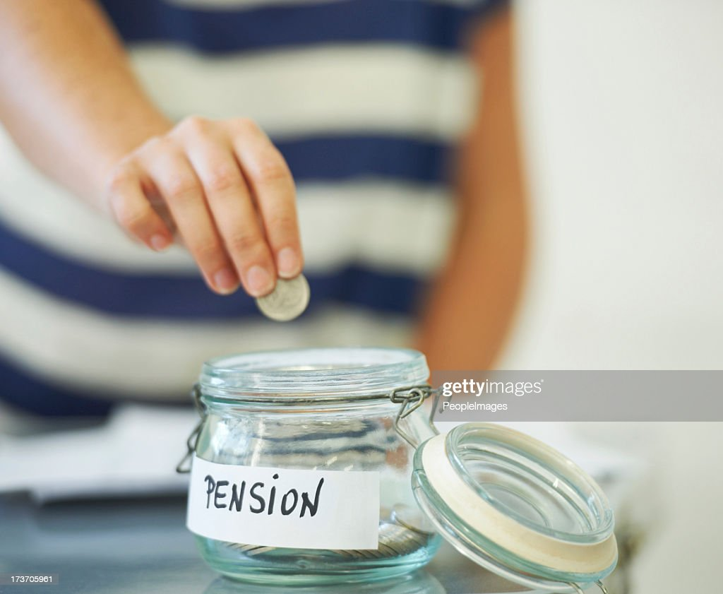Saving one penny at a time : Stock Photo