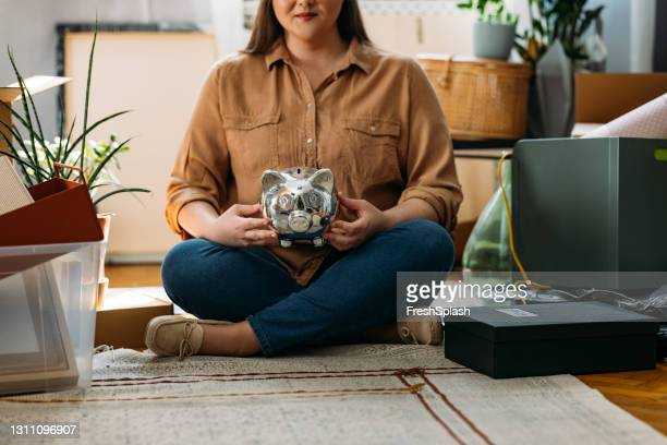 saving up for your first real estate purchase- tips and tricks for millennials - mortgage stock pictures, royalty-free photos & images