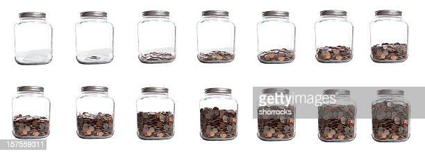 saving your coins series of jar filling - jar stock pictures, royalty-free photos & images