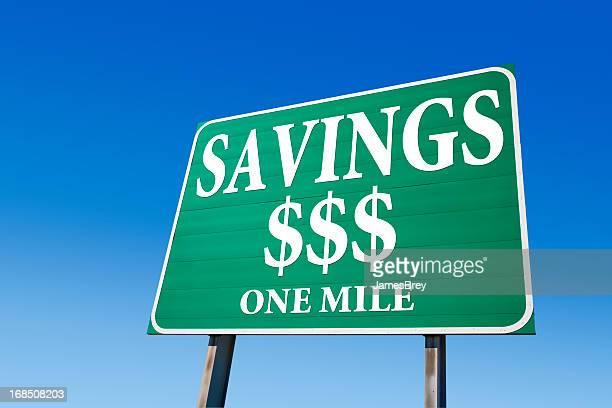 Savings, One Mile; Highway Road Sign