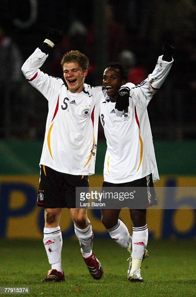Savio Nsereko of Germany celebrates scoring the first goal with team mate Florian Jungwirth during the U19 international friendly match between...