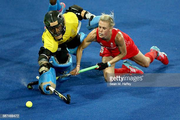 Savita Savita of India lunges past Alex Danson of Great Britain for a shot on goal during a Women's Pool B match on Day 3 of the Rio 2016 Olympic...