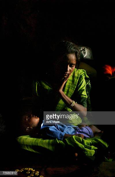 Savithasan 16 yearold rests with her second baby Sai in her mud hut in this photo taken on August 23 2005 in Mehbubnagar in Andhra Pradesh India She...