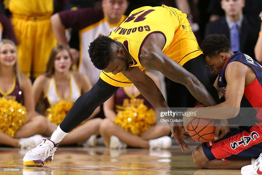 Savon Goodman #11 of the Arizona State Sun Devils fights for a loose ball with Parker Jackson-Cartwright #0 of the Arizona Wildcats during the second half of the college basketball game at Wells Fargo Arena on January 3, 2016 in Tempe, Arizona. The Arizona Wildcats beat the Arizona State Sun Devils 94-82.