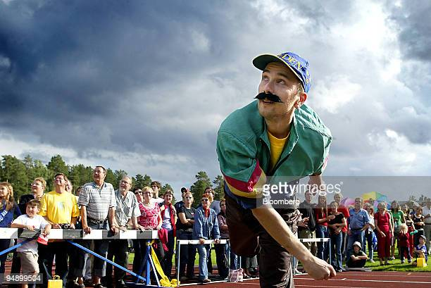 Savonlinna native tosses a phone in the Freestyle class during the sixth annual MobilePhone Throwing World championships in Savonlinna Finland on...