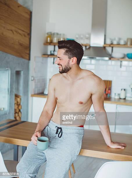 Savoring his morning coffee